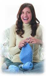 woman in jeans knitting