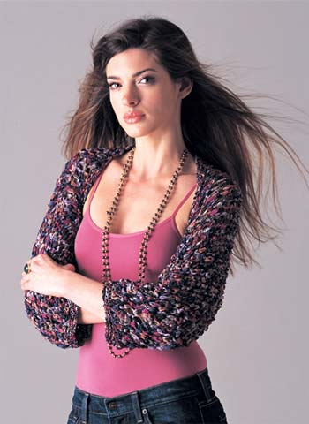 model wearing multi-colored knit shrug