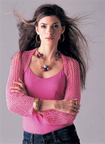 model wearing pink knit shrug